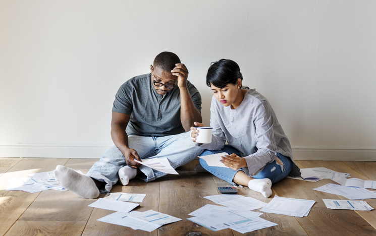 Couple managing the debt